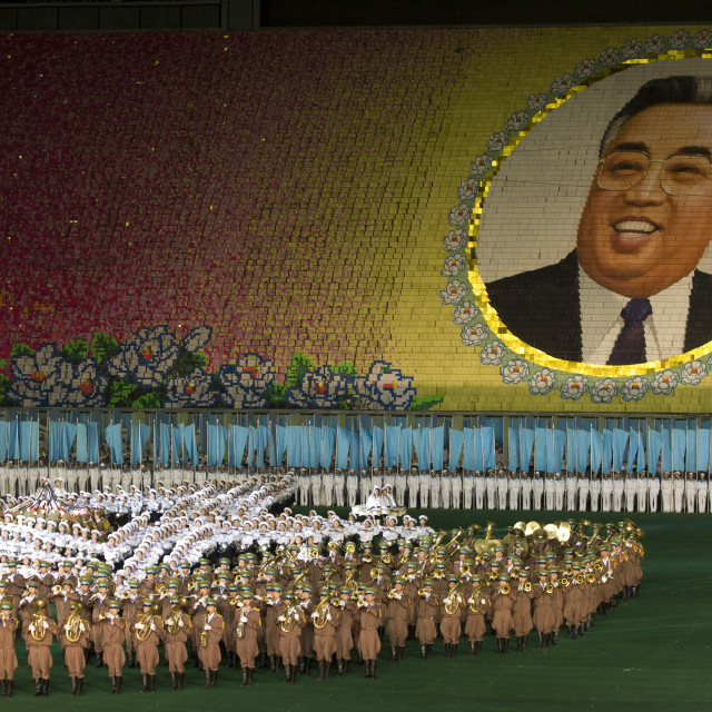 """Kim il Sung portrait made by children pixels holding up colored boards during..."" stock image"