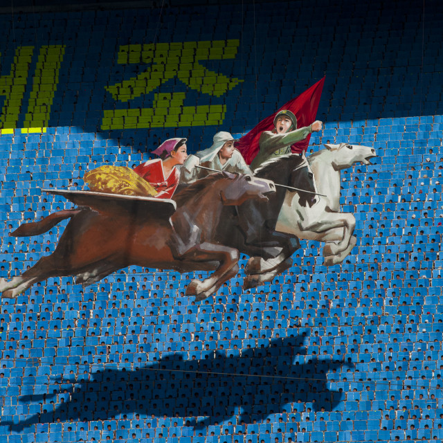 """""""Chollima horses made by children pixels holding up colored boards during..."""" stock image"""