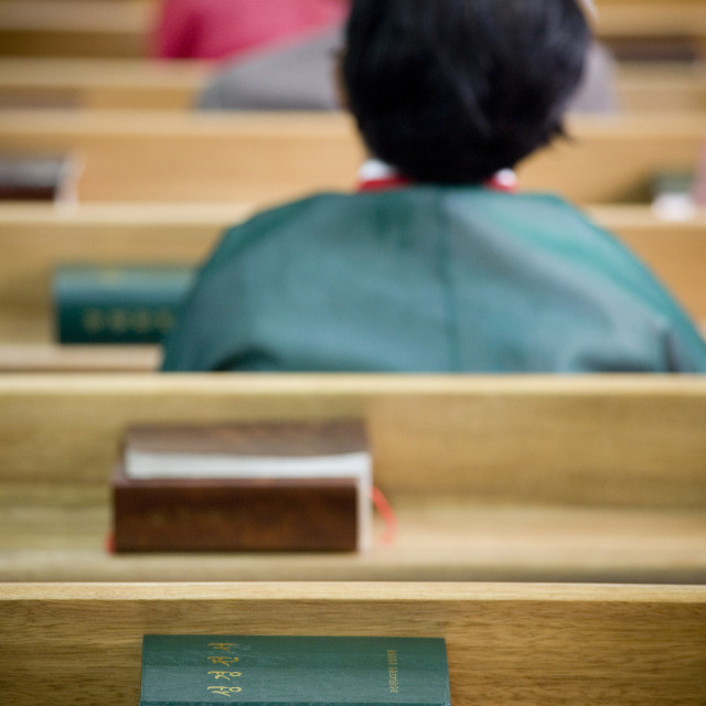 """North Korean worshiper reading the bible during a sunday mass in protestant..."" stock image"