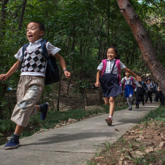 """North Korean children running in a park, Pyongan Province, Pyongyang, North..."" stock image"