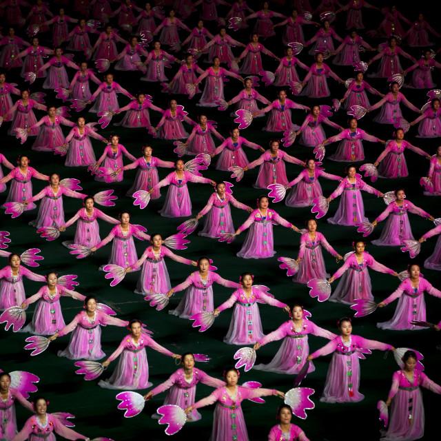 """North Korean women dancing in choson-ot during the Arirang mass games in may..."" stock image"