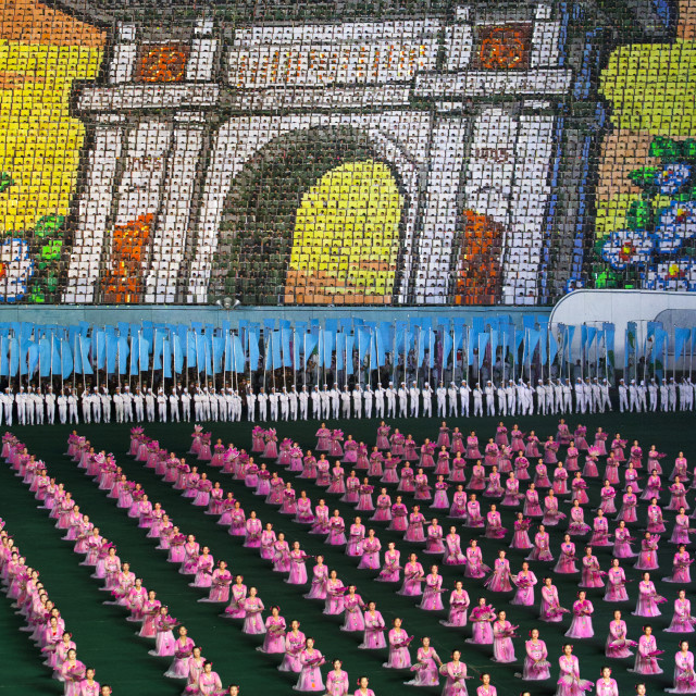 """""""Arch of triumph made by children pixels holding up colored boards during..."""" stock image"""