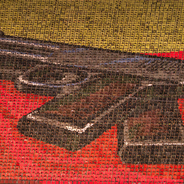 """""""Kim il Sung pistol made by children pixels holding up colored boards during..."""" stock image"""