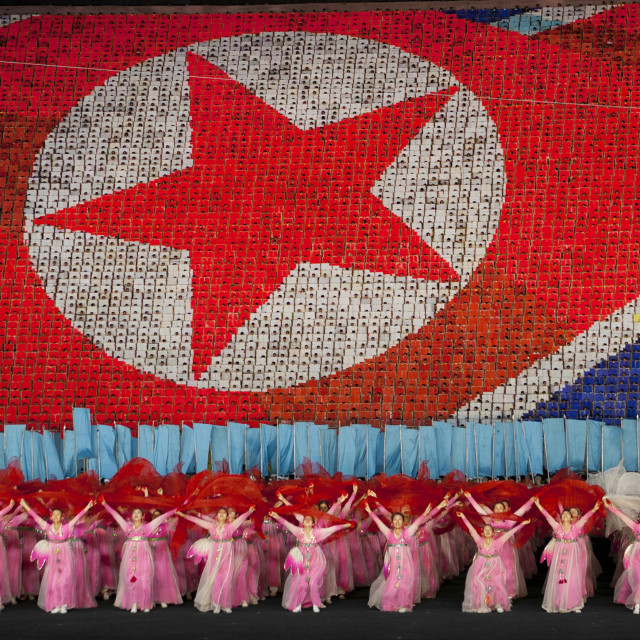 """North Korean flag made by human pixels holding up colored boards during..."" stock image"