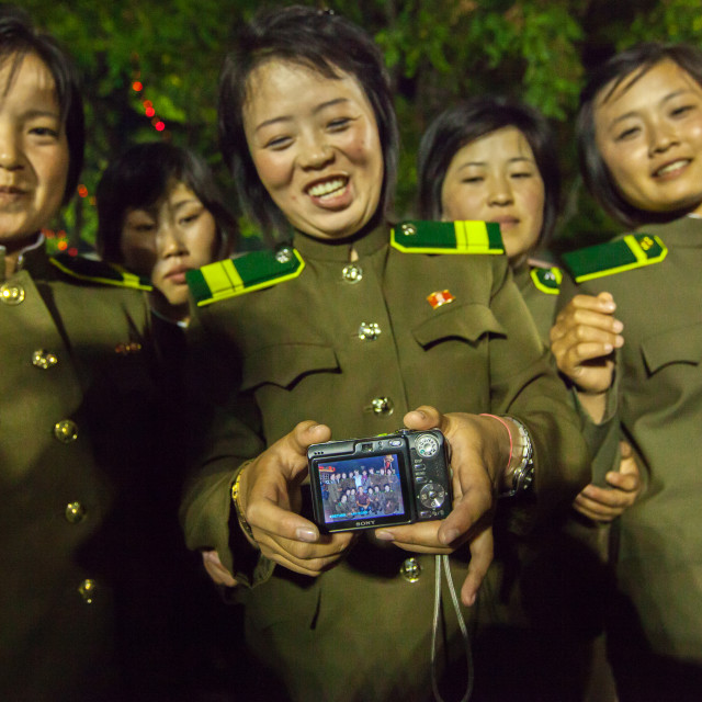 """North Korean women soldiers showing a camera screen, Pyongan Province,..."" stock image"