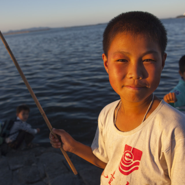 """""""Portrait of a North Korean child boy fishing in the sea, Kangwon Province,..."""" stock image"""