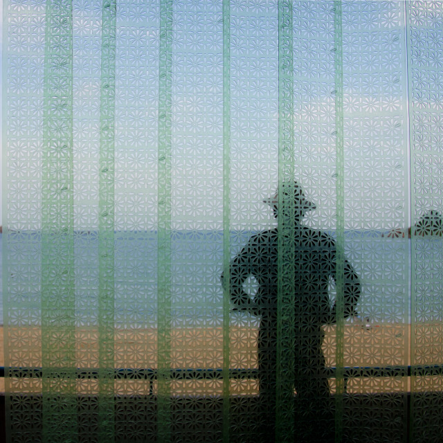 """""""North Korean man on a balcony in front of a beach, North Hamgyong Province,..."""" stock image"""
