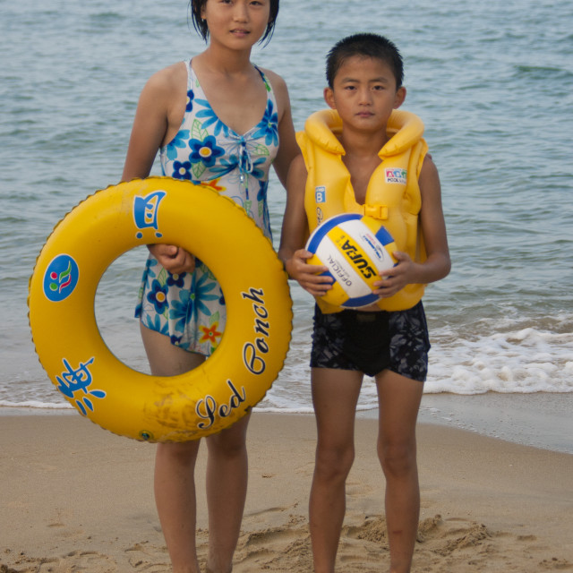 """""""North Korean children on a beach with rubber ring and ball, North Hamgyong..."""" stock image"""