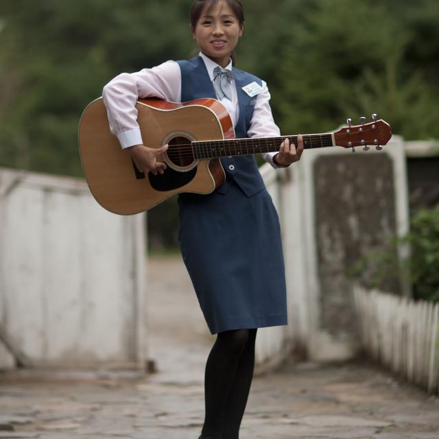 """""""North Korean woman playing guitar, North Hamgyong Province, Jung Pyong Ri,..."""" stock image"""