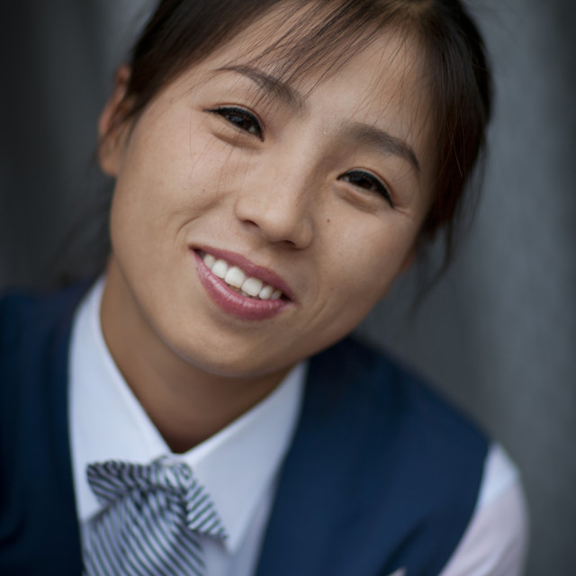 """""""Portrait of a North Korean young woman smiling, North Hamgyong Province, Jung..."""" stock image"""