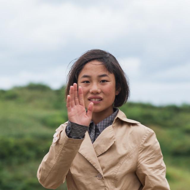 """""""North Korean teenage girl waving hand, North Hamgyong Province, Jung Pyong..."""" stock image"""