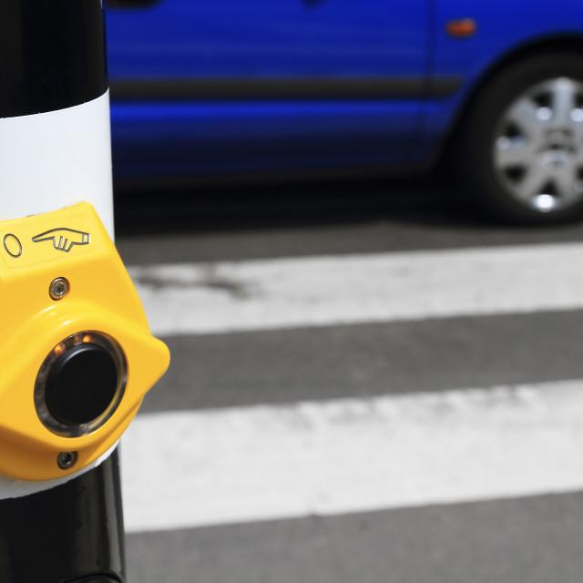 """Yellow crosswalk button blue car"" stock image"