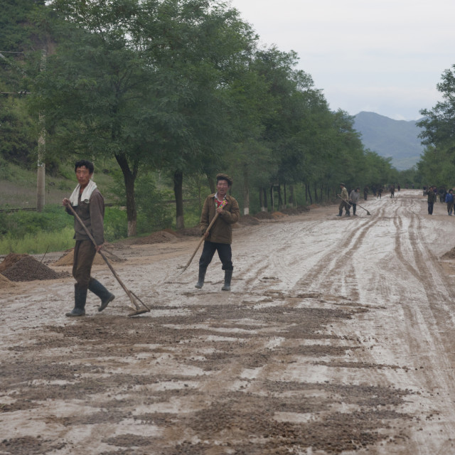 """""""North Korean workers repairing muddy roads in the countryside, North Hamgyong..."""" stock image"""
