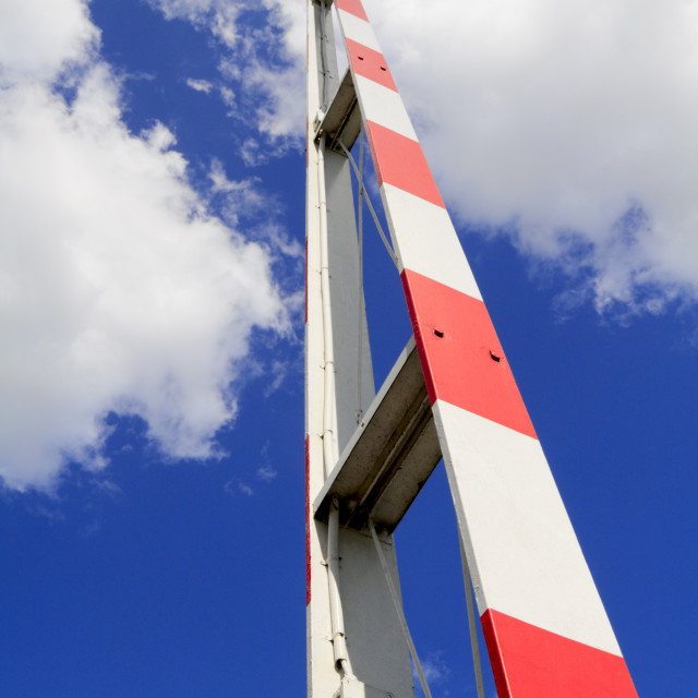 """""""Red and white raised barrier"""" stock image"""