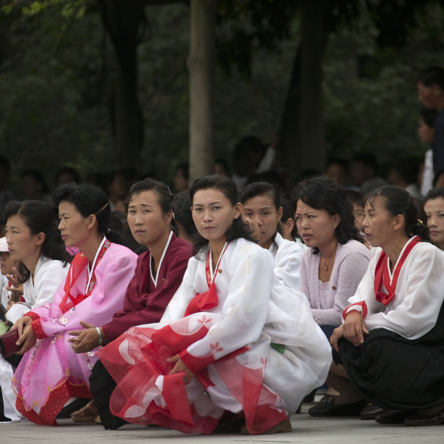 """""""North Korean people squatting and waiting to visit the Kim il Sung..."""" stock image"""