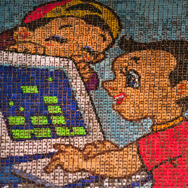 """""""North Korean kids using a computer made by children holding up colored boards..."""" stock image"""