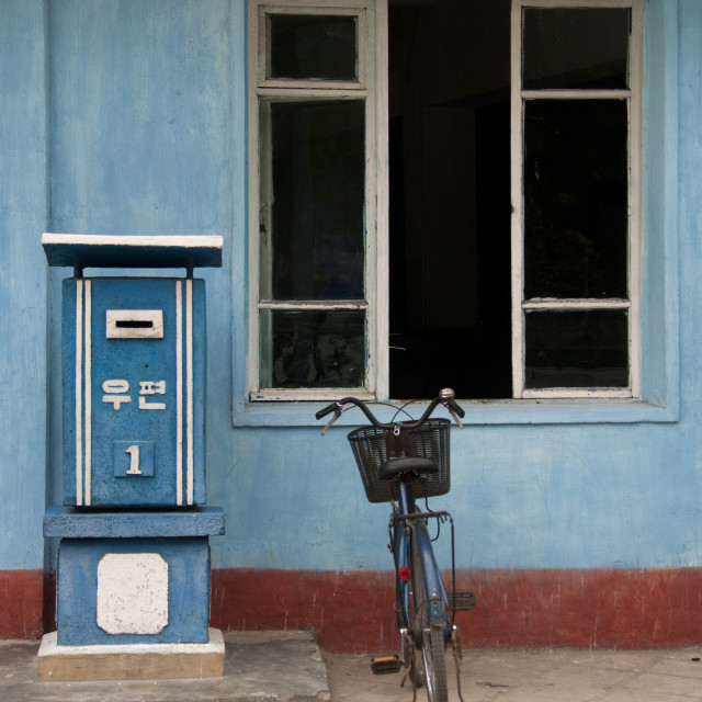 """""""A bicycle parked next to a mail box, North Hwanghae Province, Kaesong, North..."""" stock image"""