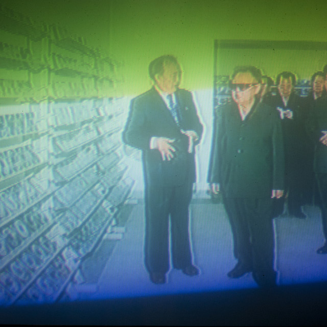"""""""Kim Jong il and Kim Jong un on North Korean television during an official..."""" stock image"""
