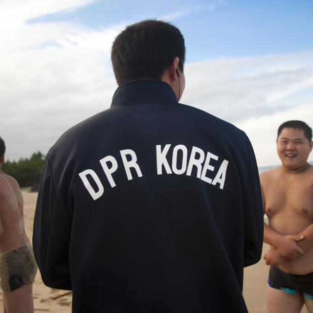 """North Korean judo team on a beach, North Hamgyong Province, Chilbo Sea, North..."" stock image"