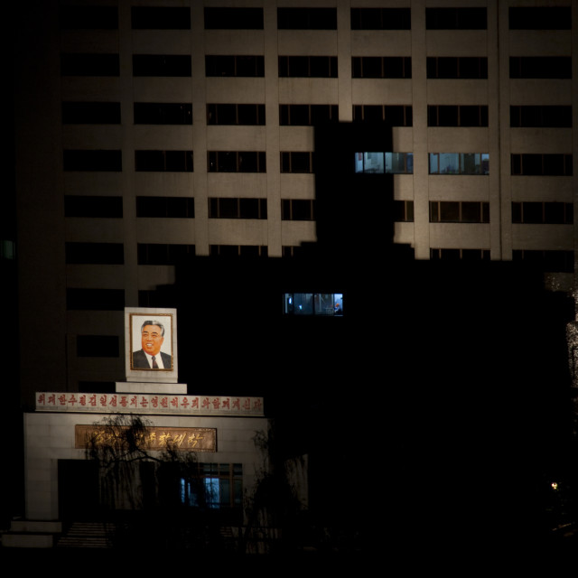 """Portrait of Kim jung il enlightened on a building in the night, Pyongan..."" stock image"