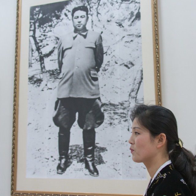 """""""North Korean woman in Jonsung revolutionary museum in front of Kim Il-sung..."""" stock image"""