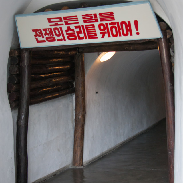 """""""Tunnel in Jonsung revolutionary museum with the slogan all the powers for the..."""" stock image"""