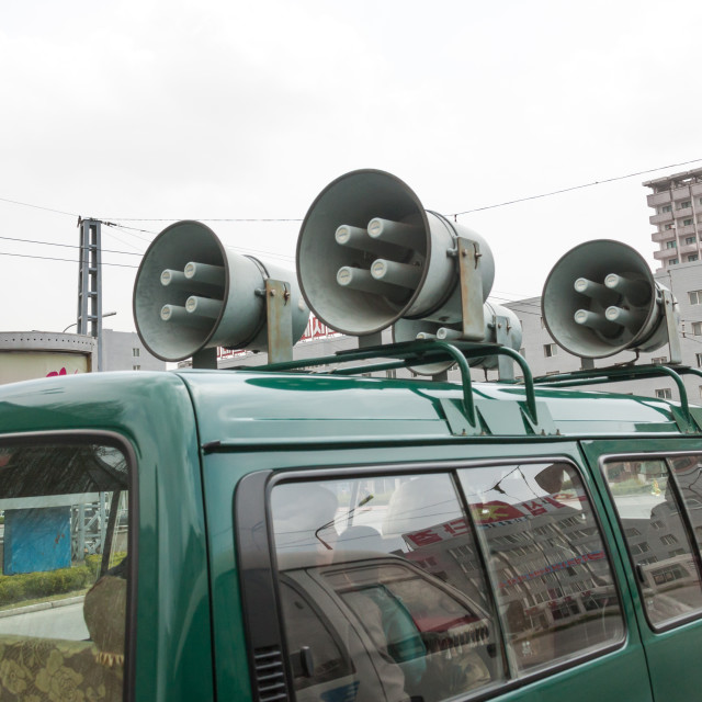 """""""Propaganda car with loudspeakers on the roof in the street, Pyongan Province,..."""" stock image"""