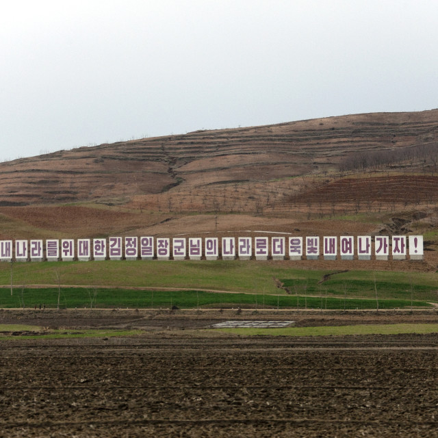 """Propaganda billboard in a field, Pyongan Province, Pyongyang, North Korea"" stock image"