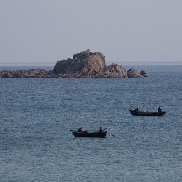 """North Korean fishermen on small boats, Kangwon Province, Wonsan, North Korea"" stock image"