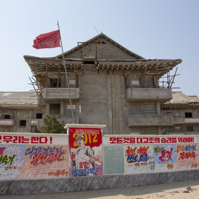 """Propaganda billboards in front of a building under construction, Kangwon-do,..."" stock image"