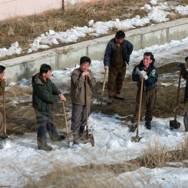 """""""North Korean men removing snow in the street, Ryanggang Province, Samjiyon,..."""" stock image"""