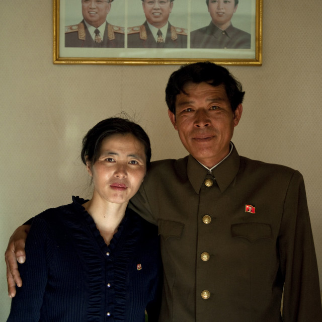"""""""North Korean couple posing in front of the official portraits of the Dear..."""" stock image"""