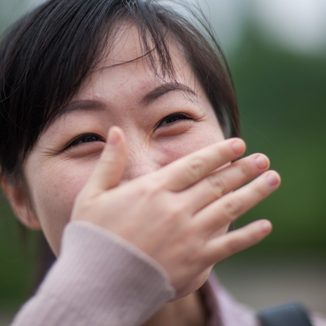 """Portrait of a shy North Korean woman, Pyongan Province, Pyongyang, North Korea"" stock image"