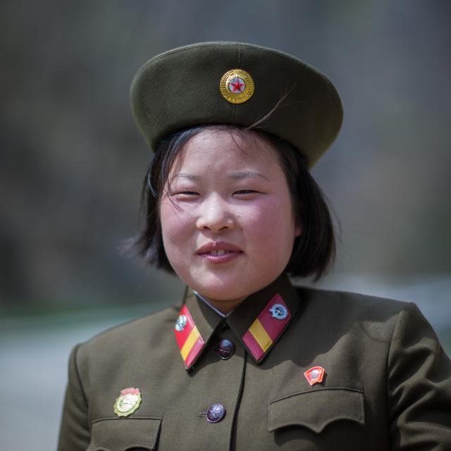 """Smiling North Korean female soldier, Kangwon Province, Wonsan, North Korea"" stock image"