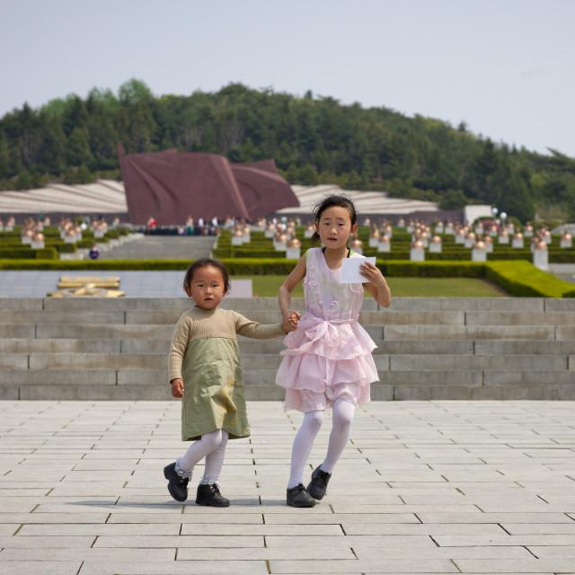 """North Korean children in the Taesongsan revolutionary martyr's cemetery,..."" stock image"