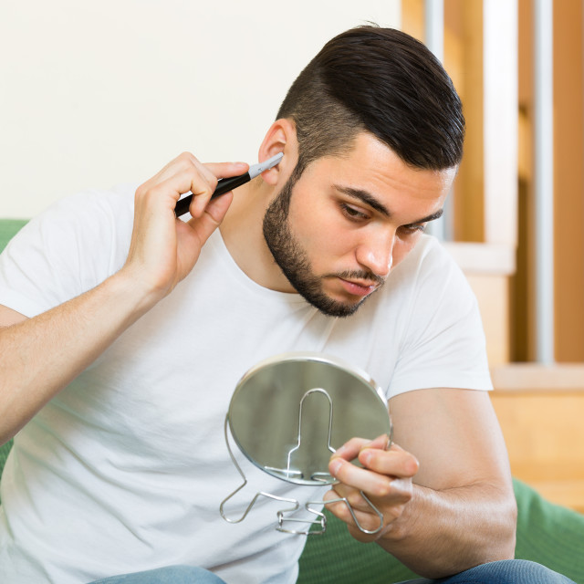 """""""Young man using hair trimmer"""" stock image"""