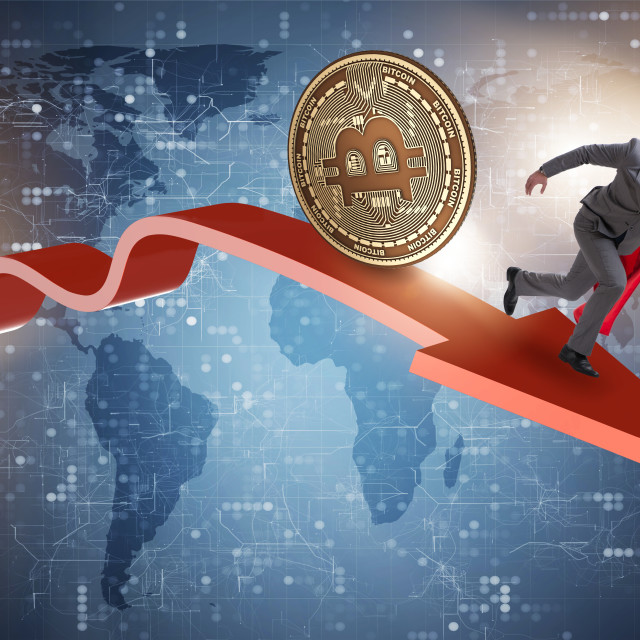 """""""Bitcoin chasing businessman in cryptocurrency price crash"""" stock image"""
