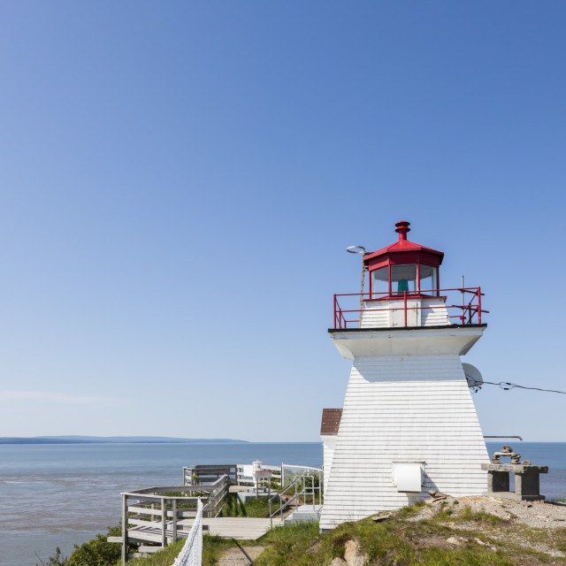 """Cape Enrage Lighthouse in the Bay of Fundy"" stock image"