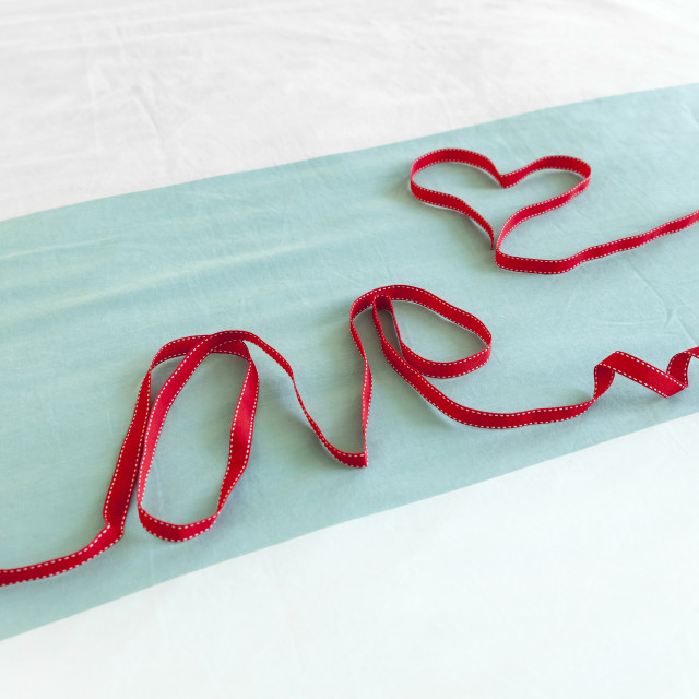 """Word ""Love"" made from red ribbon"" stock image"