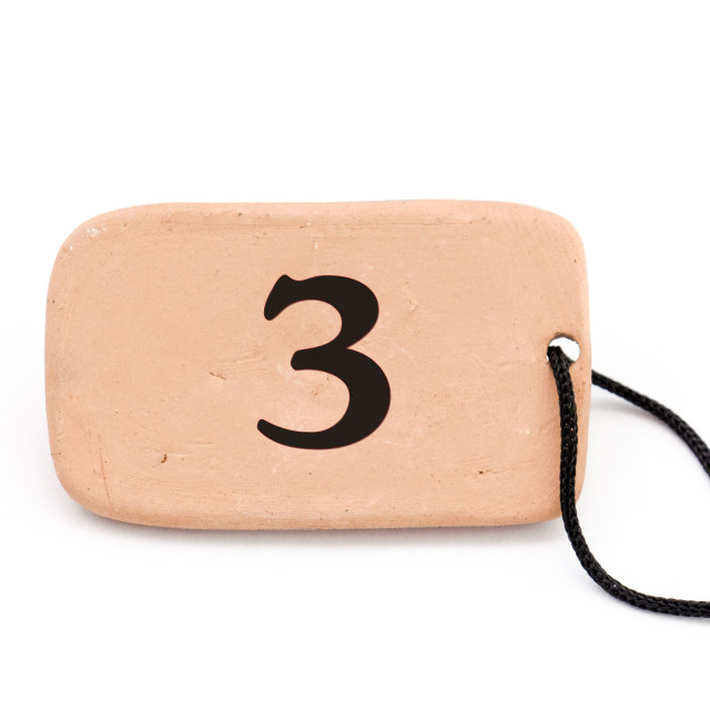 """number on , brown ceramic plate ,necklace, on white background"" stock image"
