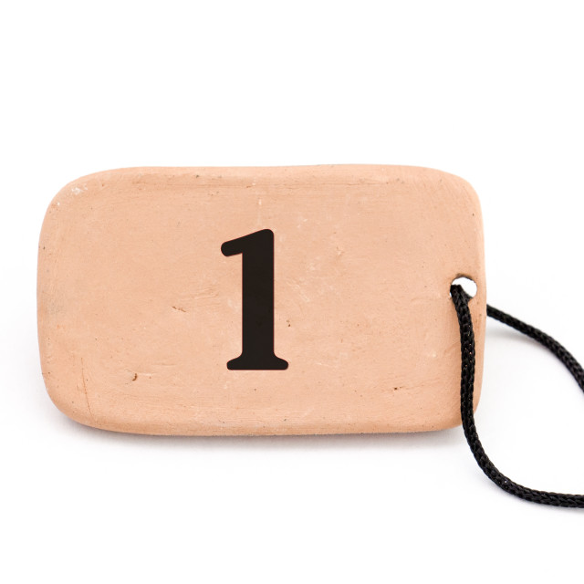 """number one , brown ceramic plate ,necklace, on white background"" stock image"