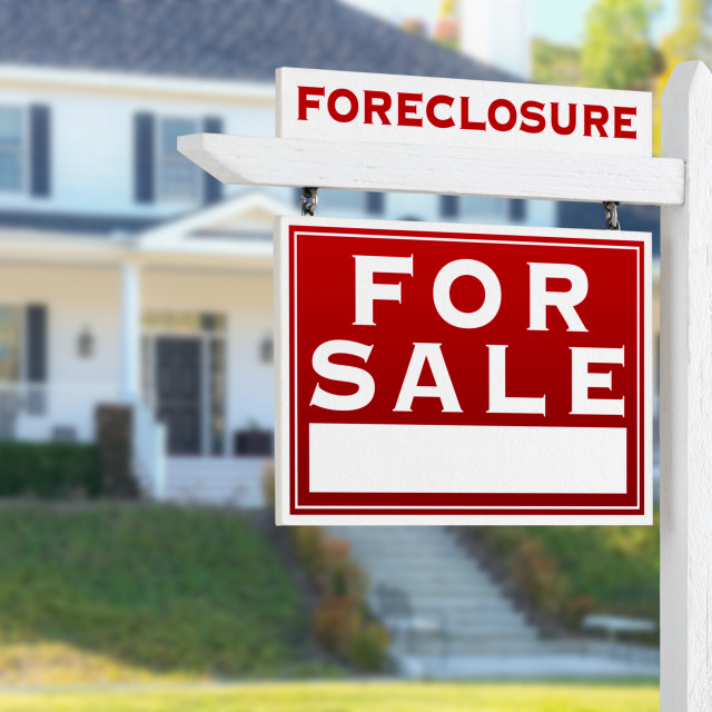 """""""Left Facing Foreclosure For Sale Real Estate Sign in Front of House."""" stock image"""