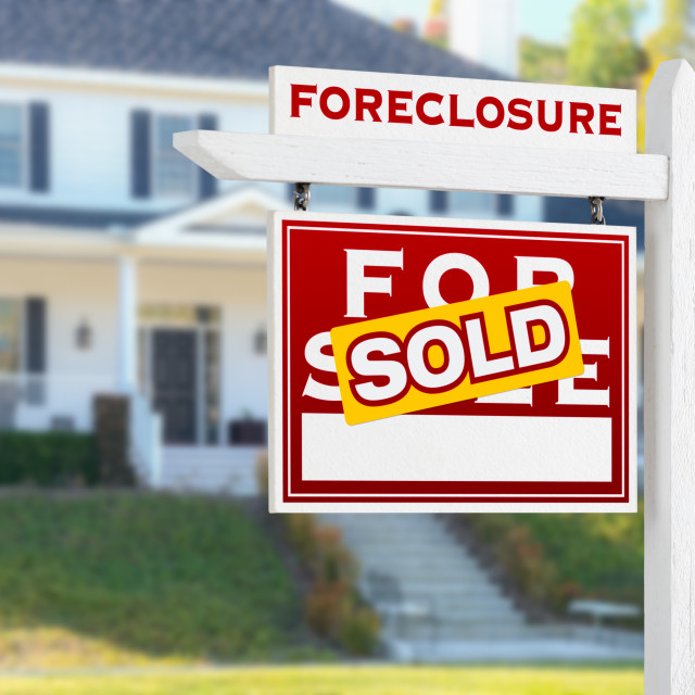 """Left Facing Foreclosure Sold For Sale Real Estate Sign in Front of House."" stock image"