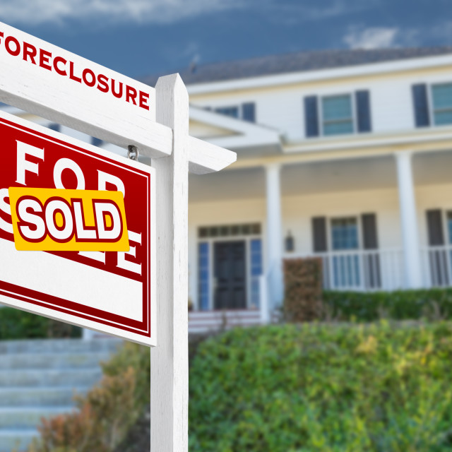 """""""Left Facing Foreclosure Sold For Sale Real Estate Sign in Front of House."""" stock image"""