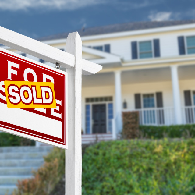 """Left Facing Sold For Sale Real Estate Sign In Front of House."" stock image"