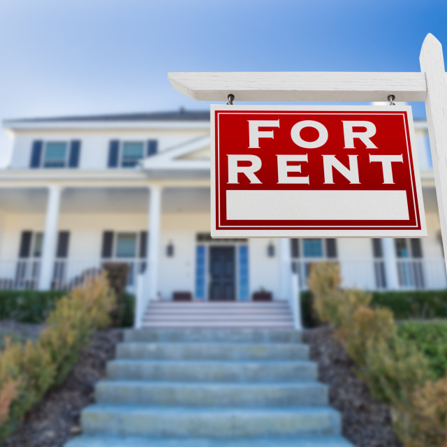 """Left Facing For Rent Real Estate Sign In Front of House."" stock image"