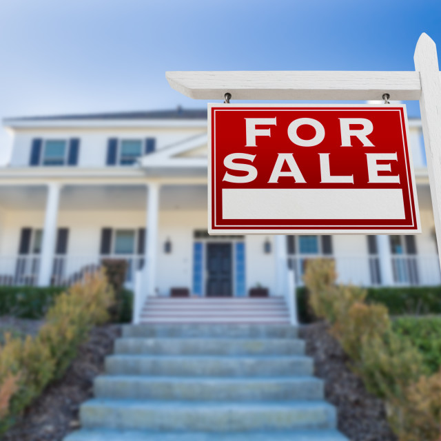 """Left Facing For Sale Real Estate Sign In Front of House."" stock image"