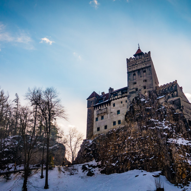 """Snow surrounding Dracula's Bran Castle in Transylvania"" stock image"