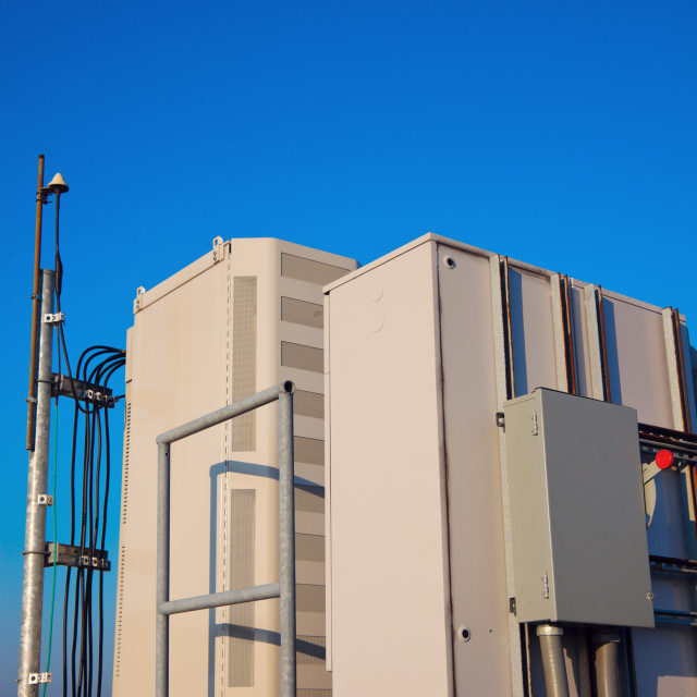 """Radio cabinet on the cell tower site"" stock image"