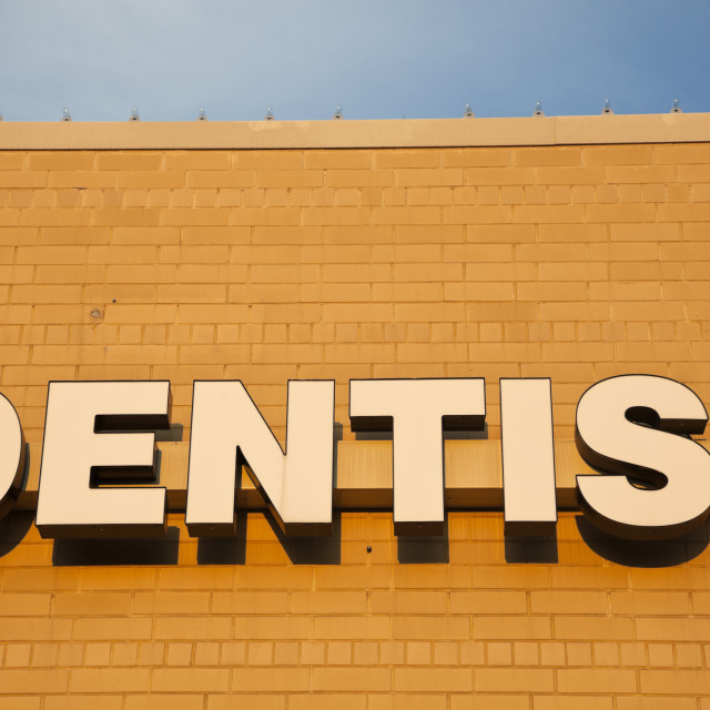 """""""Dentist sign on the brick wall"""" stock image"""